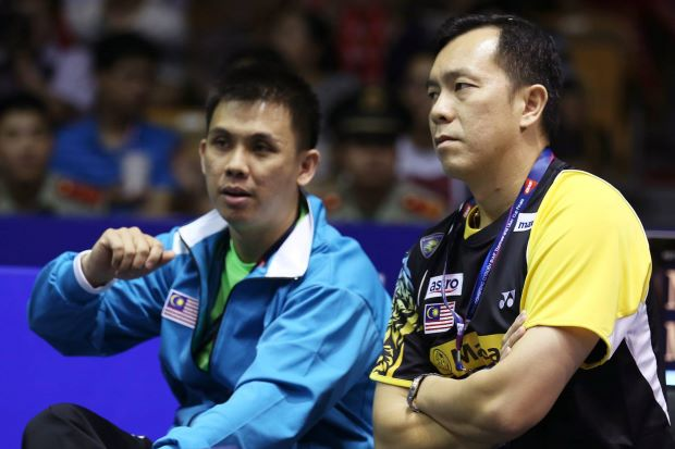 Tan Kim Her (right) seen here with national doubles coach Pang Cheh Chang during the 2012 Thomas Cup championship in China, will know his fate soon as his contract with BAM expires this month.