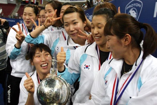 The Korean women's badminton team celebrating with the Uber Cup trophy after shocking China in the final in KL in 2010.