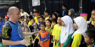 Former national chief coach and player Yap Kim Hock, seen here with kids from Pandamaran at his badminton academy, has applied for the men's doubles coaching position with BAM on Friday.