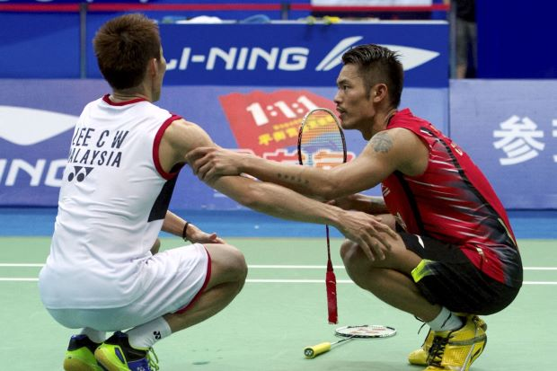 In World Championships 2013, Lee Chong Wei had to throw in the towel when he succumbed to cramps during the final World Championships match against China's Lin Dan (right).