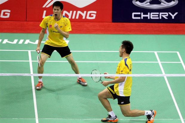 Tan Wee Kiong-Goh V Shem celebrate after delivering the winning point for Malaysia by beating South Korea's world No.4 Kim Ki-jung-Kim Sa-rang.