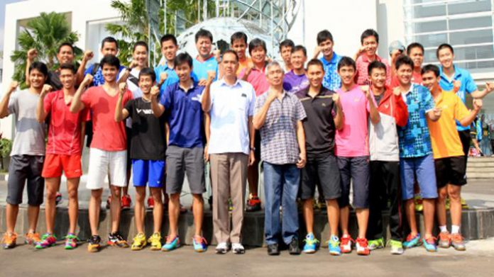 Shuttlers and coaches from Indonesia's Thomas Cup
