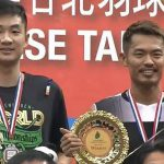 Lin Dan (right) on the podium with Wang Zhengming