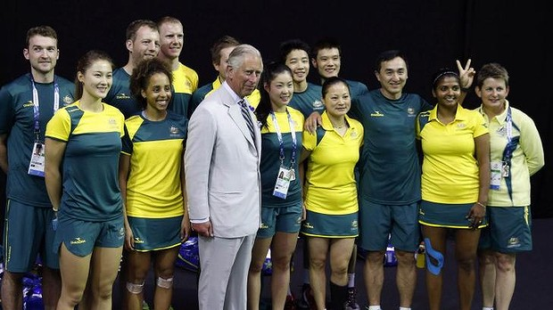 Prince Charles poses with members of the Australia badminton team in the lead up to the Games.