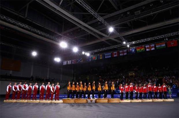 "England, Malaysia, Singapore (from left) stand on podium for national anthem of Malaysia - ""Negaraku"""
