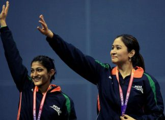 Jwala Gutta (right) and Ashwini Ponnappa wave after winning gold in the women's badminton doubles event of Commonwealth Games in New Delhi on October 14, 2010.