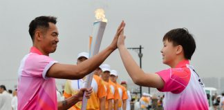 Lin Dan was among the torchbearers of the 2014 Nanjing Youth Olympics torch relay