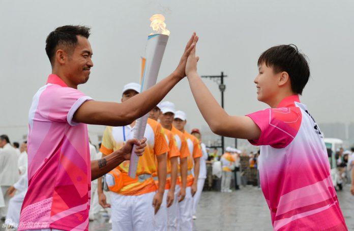 Lin Dan was among the torchbearers of the 2014 Nanjing Youth Olympics torch relay
