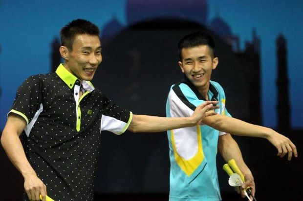 Lee Chong Wei (left) and Chong Wei Feng enjoy a lighter moment during a practice session