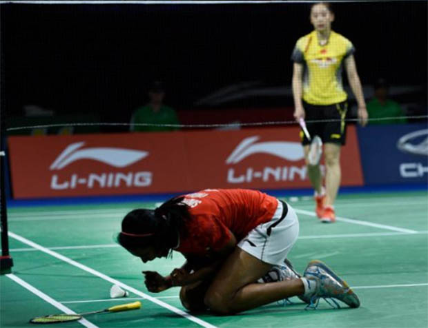 P.V. Sindhu celebrates after her victory against Wang Shixian