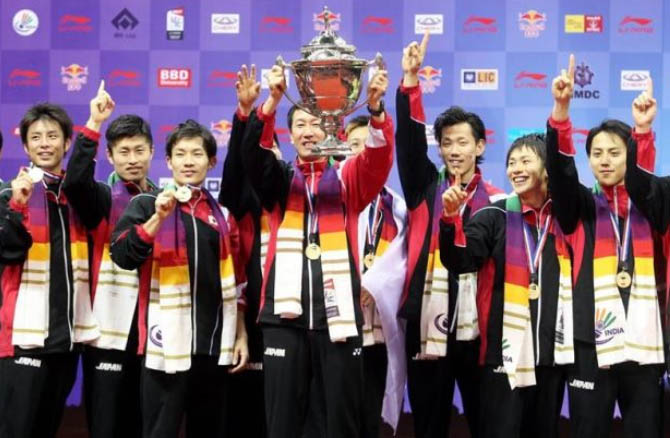 Japan head coach Park Joo-bong holds aloft the Thomas Cup after they beat Malaysia 3-2 in the Thomas Cup final in New Delhi last May.