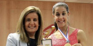 Spanish Minister Fatima Banez (L) delivers the Sport Merit Royal Order to Carolina Marin on September 2, 2014 in Madrid, Spain.