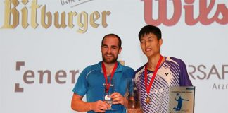 Chou Tien Chen (right) and Scott Evans are holding their trophies