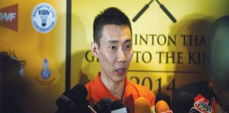 Malaysia's Lee Chong Wei speaks to the media during a news conference in Bangkok yesterday.