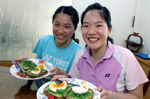 Wish Ng Hui Lin (right) and Ng Hui Ern good luck as they move onto the next stage in their life.