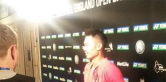 Lin Dan talks to reporters after Thursday's match (photo: Reuters)