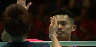 Lin Dan shakes hand with Kento Momota after the match