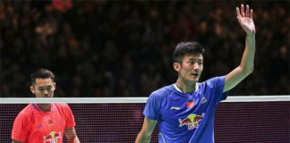 Chen Long (blue shirt) waves at the crowd after he won his All England semi-final match against Lin Dan