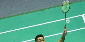 Lin Dan returns a shot at the Badminton Asia Championships