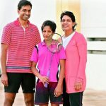Gayatri with her parents, India coach P. Gopichand and former Indian national badminton champion Lakshmi.