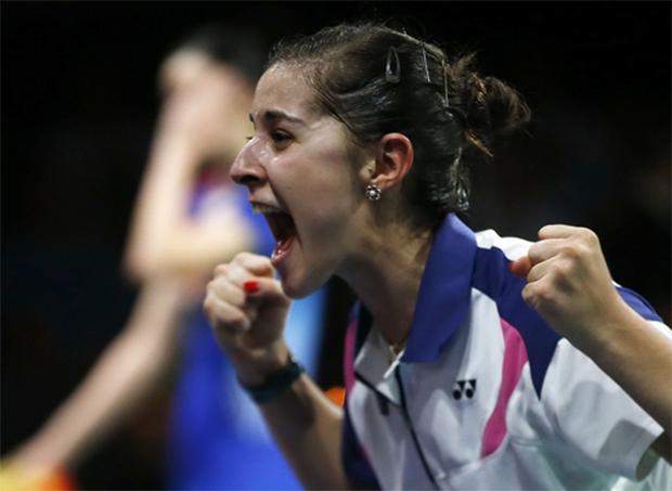 Carolina Marin of Spain cannot believe she has just beaten China's Li Xuerui to become world champion, August 31, 2014.