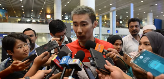 Lee Chong Wei talks to reporters upon his arrival in Kuala Lumpur.