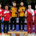 (L-R) Silver medalists Chayut Triyachart and Danny Bawa Chrisnanta of Singapore, gold medalists Tan Wee Kiong and Goh V Shem of Malaysia and bronze medalists Peter Mills and Chris Langridge of England at Glasgow 2014 Commonwealth Games.