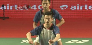 Cai Yun (front) partners Hendra Gunawan in their India's Premier Badminton League debut last Saturday. (photo: 163)
