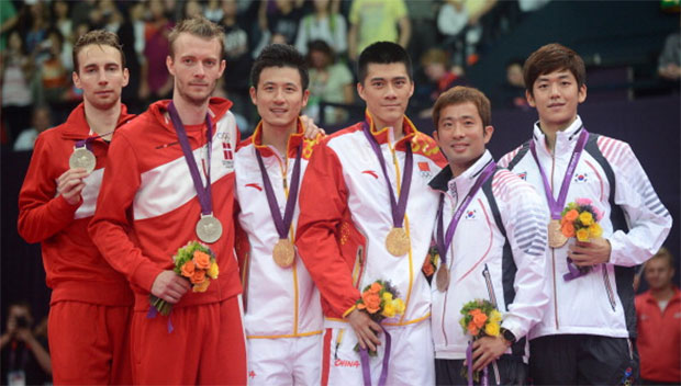 Denmark's Mathias Boe and Carsten Mogensen, (L) China's Cai Yun and Fu Haifeng (C) and South Korea's Chung Jae Sung and Lee Yong Dae (R) pose for pictures with their medals following the Men's Doubles badminton medal matches at the London 2012 Olympic Games in London, on August 5, 2012.