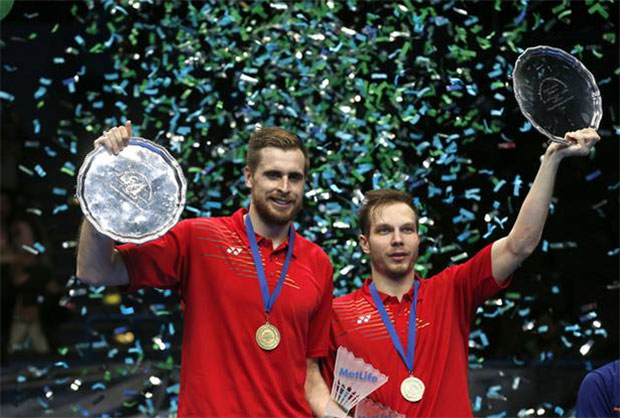 Vladimir Ivanov/Ivan Sozonov of Russia hold up the 2016 All England men's doubles champion trophy during the awarding ceremony.(photo: Reuters / Andrew Boyers)