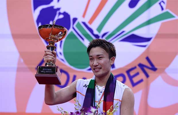 Japan's Kento Momota poses with the trophy after winning the men's final singles match aganist Denmark's Viktor Axelsen at 2016 India Open. (photo: AFP)