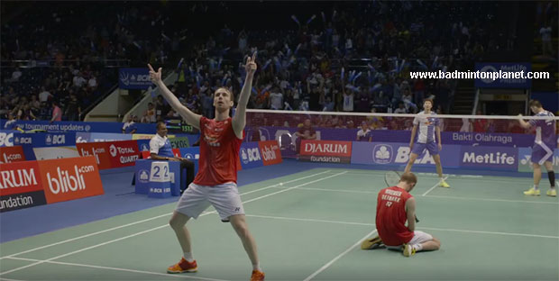 Carsten Mogensen drops to his knees while Mathias Boe celebrates their 1st round victory at the 2016 Indonesia Open.