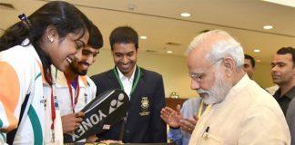 P.V Sindhu and Kidambi Srikanth get autograph from Prime Minister Narendra Modi. (photo: business-standard)
