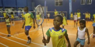 Brazilian children are practicing badminton following the Samba beat. (photo: New York Times)