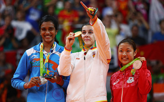 Rio 2016 women's singles silver medalist V. Sindhu Pusarla of India, gold medalist Carolina Marin of Spain and bronze medalist Nozomi Okuhara of Japan (from left). (photo: AFP)