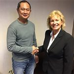Chief Executive of Badminton Scotland, Anne Smillie welcomes Wong Tat Meng to the Scotland badminton team. (photo: Badminton Scotland)
