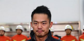 Lin Dan is wearing firefighters' uniform.