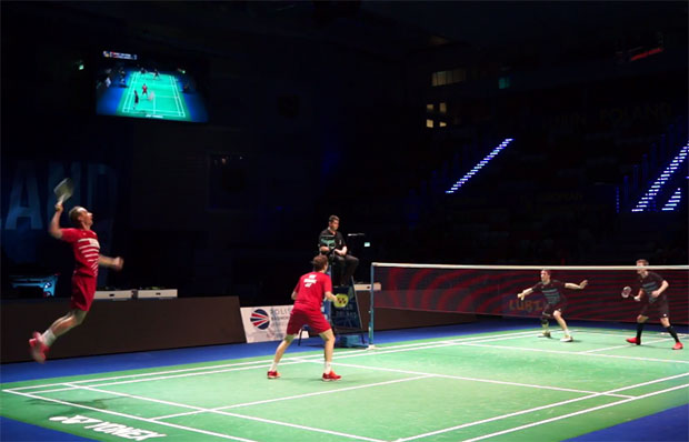 Carsten Mogensen (red shirt, left) and Mathias Boe of Denmark play against Mark Lamsfuss and Josche Zurwonne of Germany in European Mixed Team Badminton Championships semi-final.