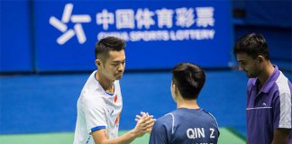 Lin Dan shakes hand with Zheng Qin before the China Masters second round match. (photo: AFP)