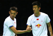 Lin Dan shakes hand with Chen Long. (photo: AP)