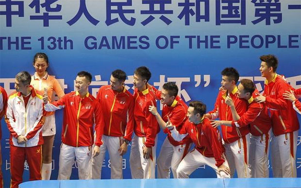 Lin Dan and the Beijing team pose with the China National Games trophy following their victory against Fujian in the final. (photo: AP)