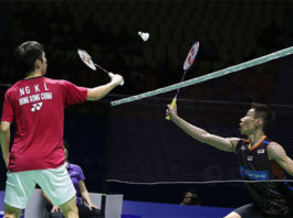Angus Ng Ka Long tries to block a shot from Lee Chong Wei during the China Open quarter-finals. (photo: AP)