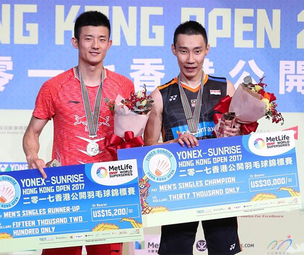 Lee Chong Wei (R) poses with Chen Long on the podium.
