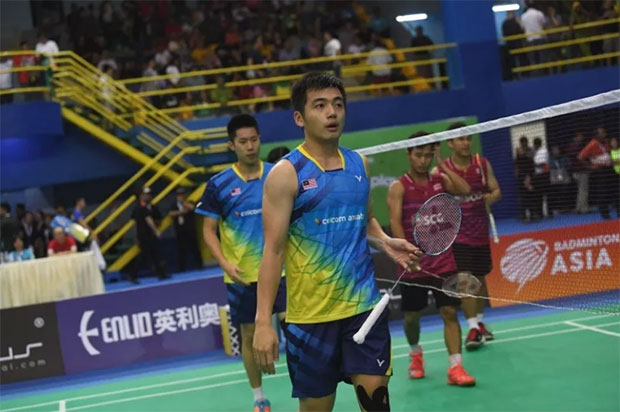 Goh V Shem/Tan Wee Kiong look disappointed with their loss at the 2018 Badminton Asia Team Championships. (photo: Bernama)
