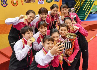 Japan's gold medal-winning BATC women's team take a selfie during the medal ceremony. (photo: AP)