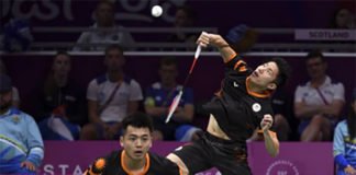 Tan Wee Kiong/Goh V Shem score the winning point for Malaysia against Scotland in the quarter-final of 2018 Commonwealth Games mixed team event. (photo: AP)