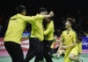 Chinese players storm the court after the Li Junhui/Liu Yuchen clinch the winning point for China. (photo: AP)