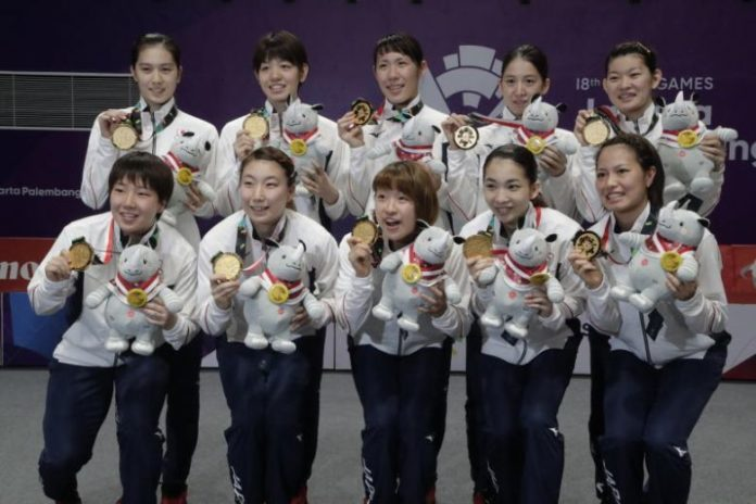 Japan wins the 2018 Asian Games badminton women's team gold medal. (photo: EPA)