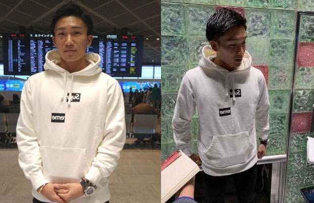 Kento Momota answers questions from reporters at Narita International Airport.