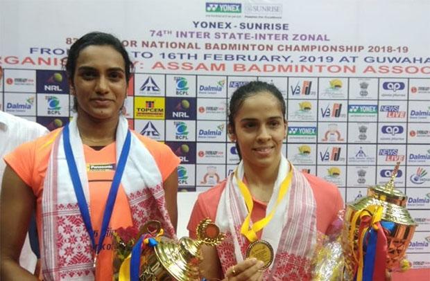 Saina Nehwal defeats PV Sindhu (L) to retain the 2019 India National Badminton Championship title. (photo: BAI Media)